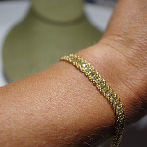 Women`s gold tone bracelet crystal accents. 7 inch